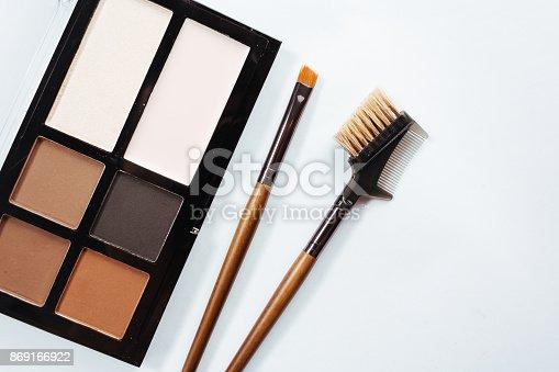 istock Eye shadow with brush on white background 869166922