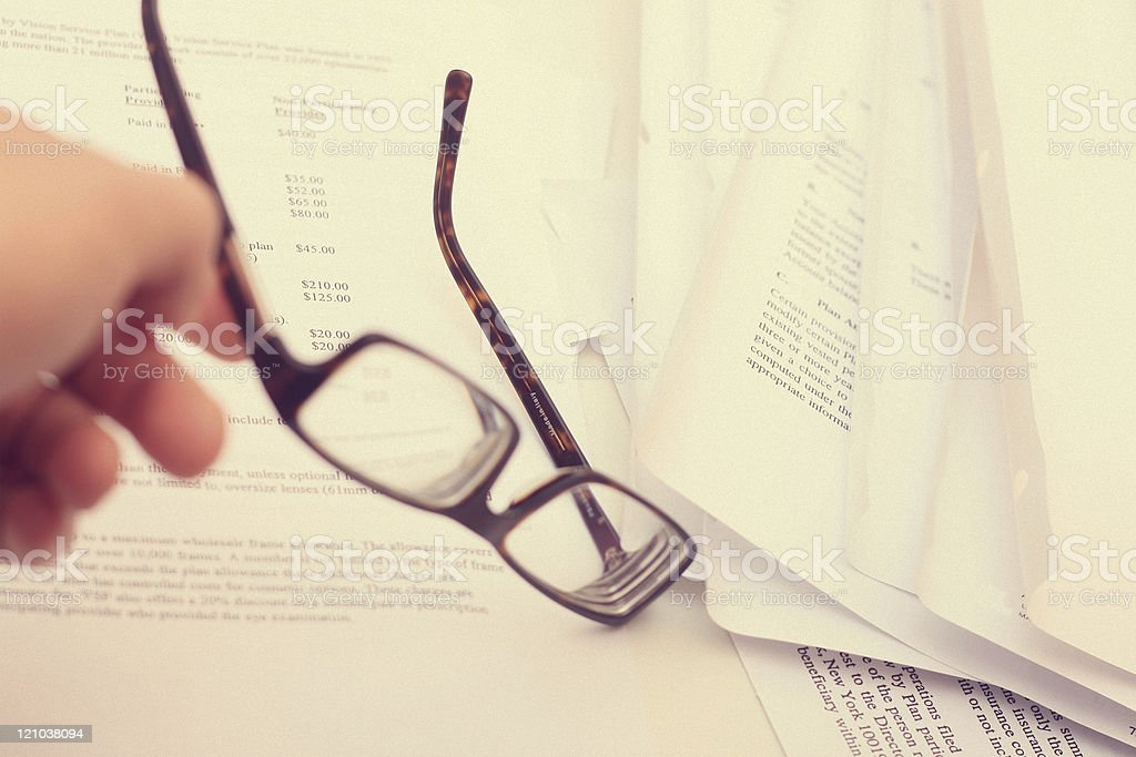 Eye Strain From Reading - Paperwork Overload stock photo
