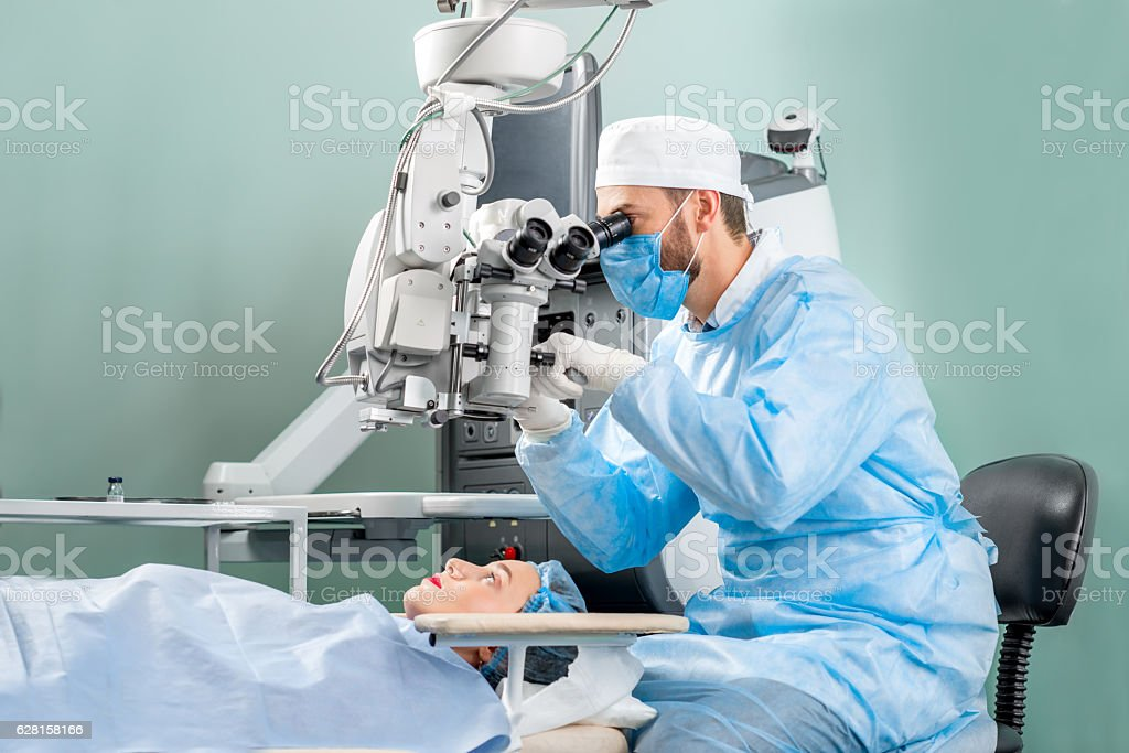 Eye surgery at the operating room stock photo