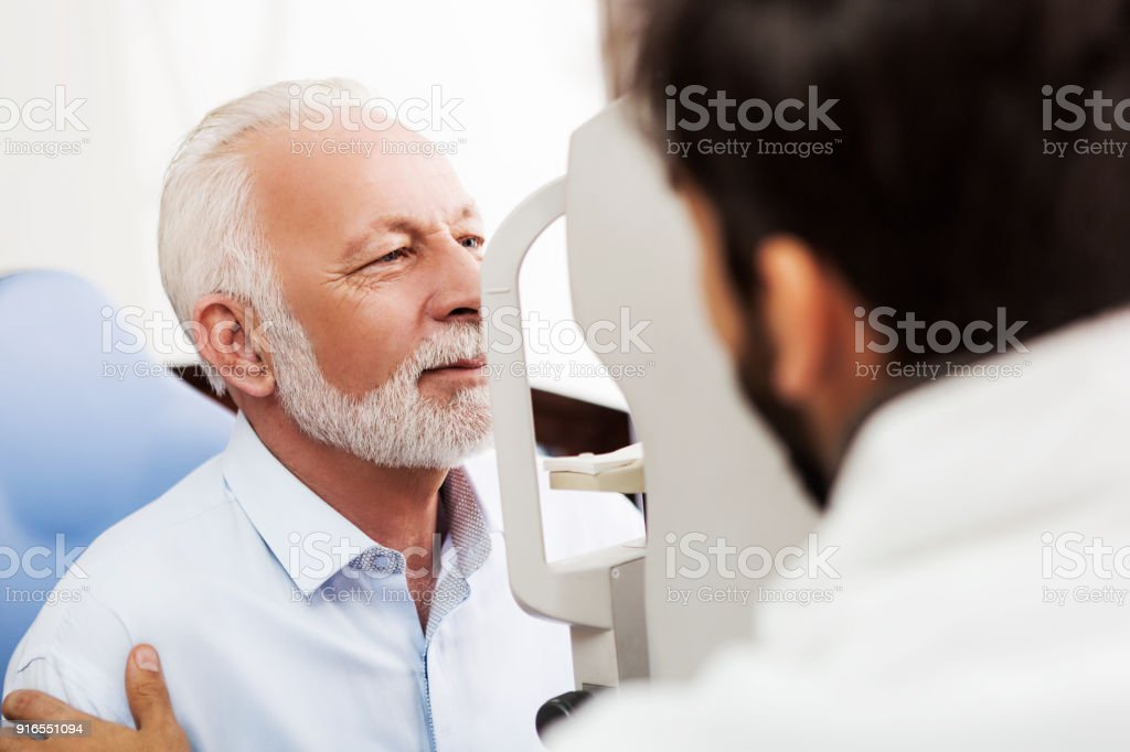 Eye test chect with optometrist stock photo