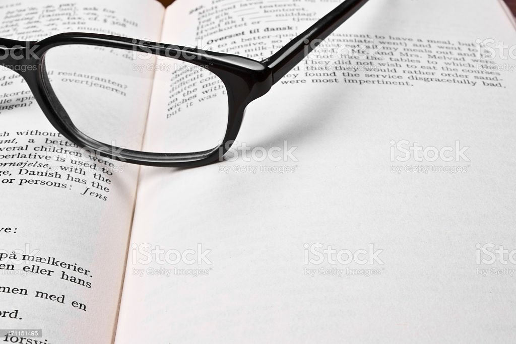 Eye wear on the book royalty-free stock photo
