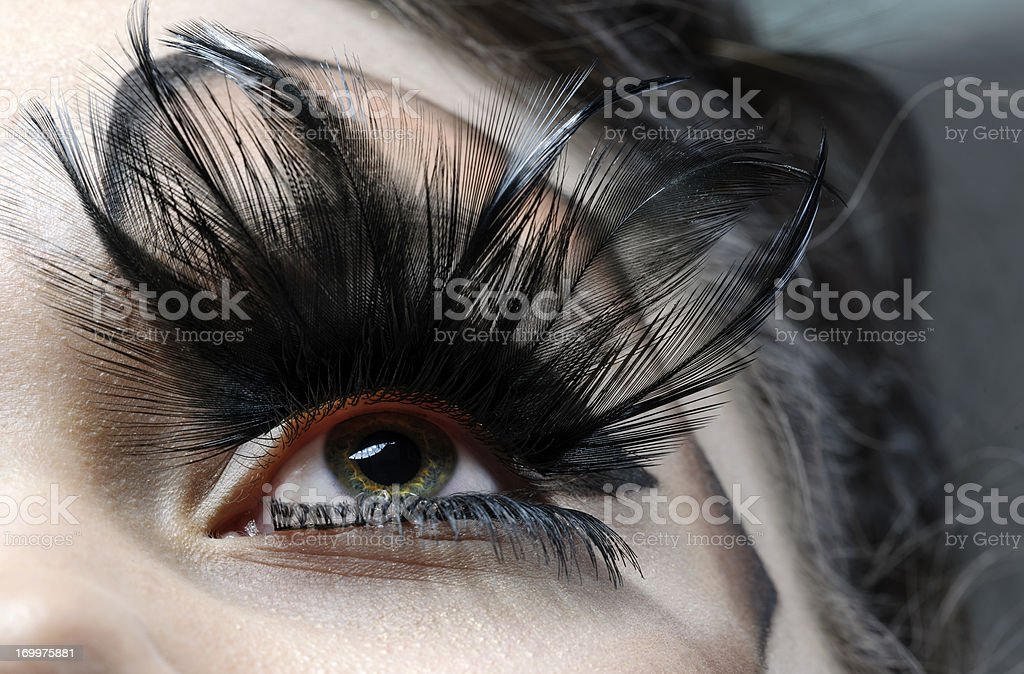 eye with feather eyelashes stock photo