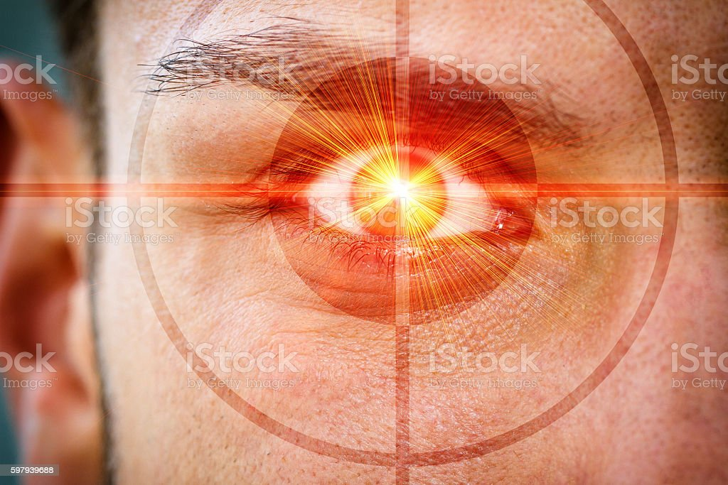Eye with red light ray stock photo