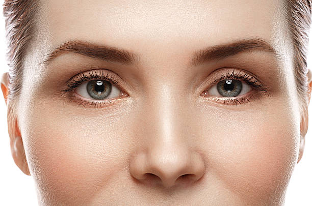 eye woman eyebrow eyes lashes - nose stock photos and pictures