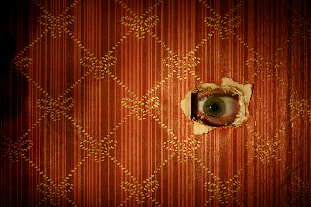 Eyeball Looking through Wall Eyeball starring through hole in the wall. creepy stalker stock pictures, royalty-free photos & images