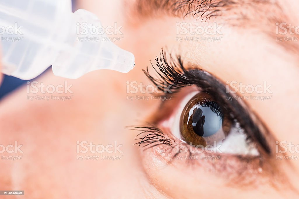 Eyedropper near eye stock photo