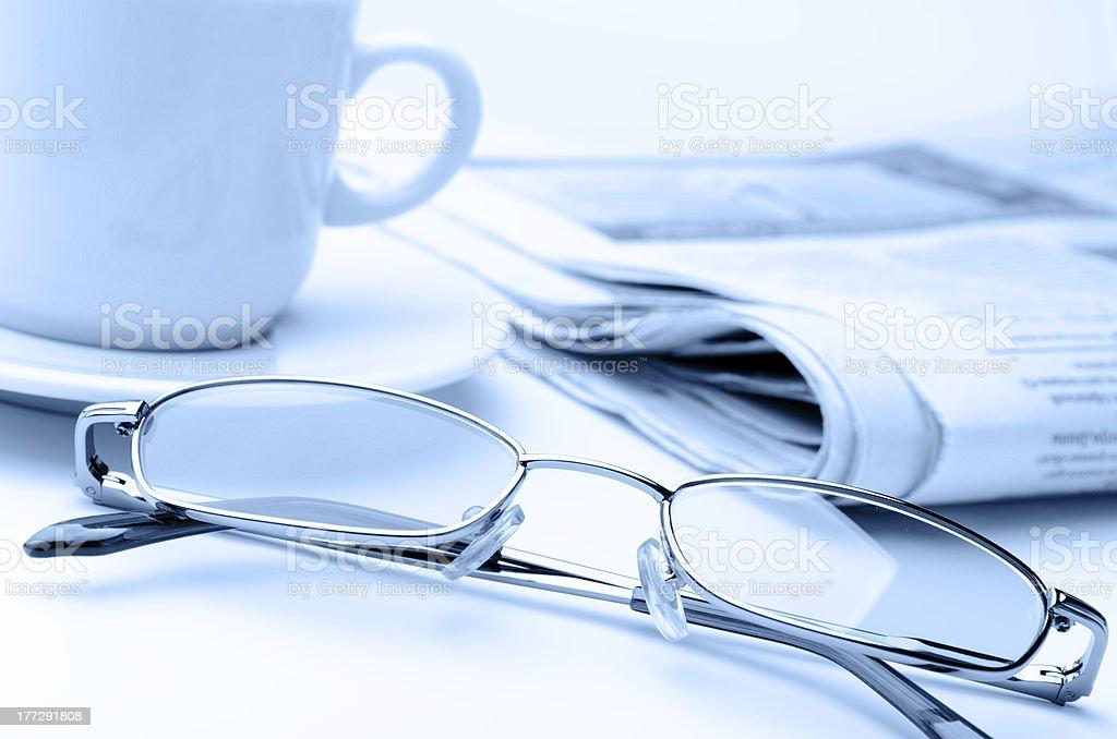 Eyeglass and newspaper royalty-free stock photo