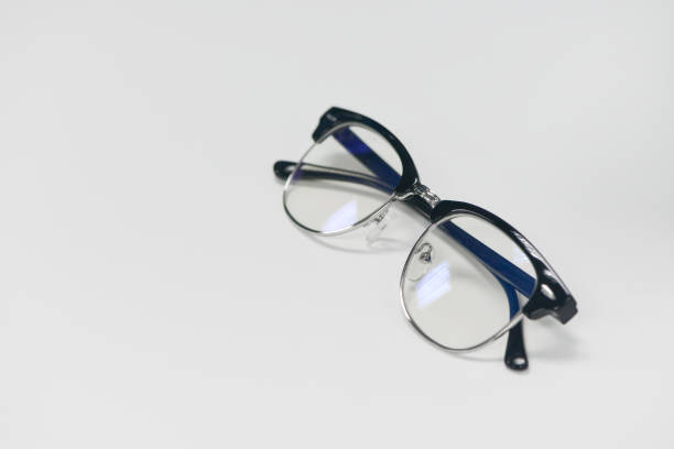 Eyeglass is on the white table stock photo