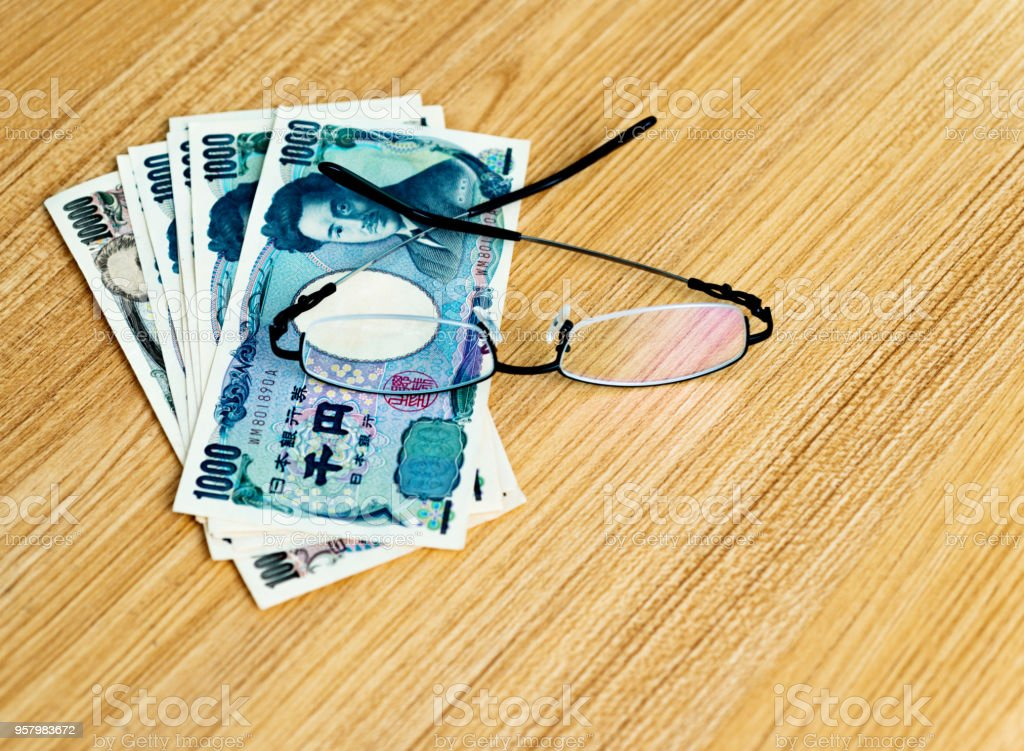 Eyeglasses and Japanese currency stock photo