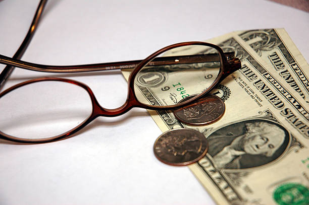 eyeglasses and money - royalty stock photos and pictures