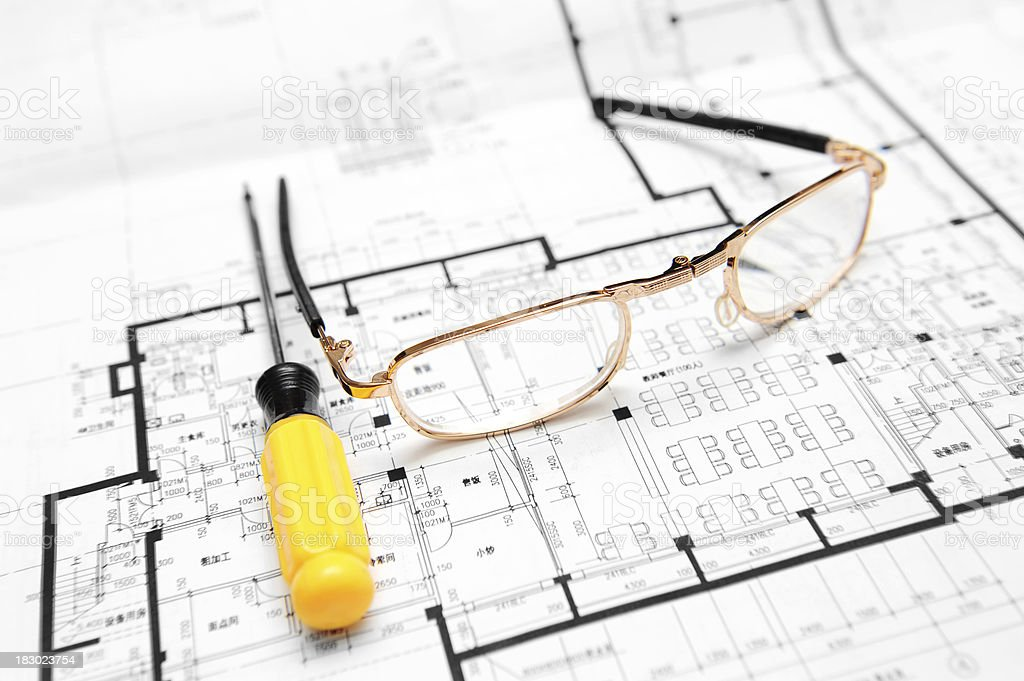 Eyeglasses and Screwdriver On Blueprint royalty-free stock photo