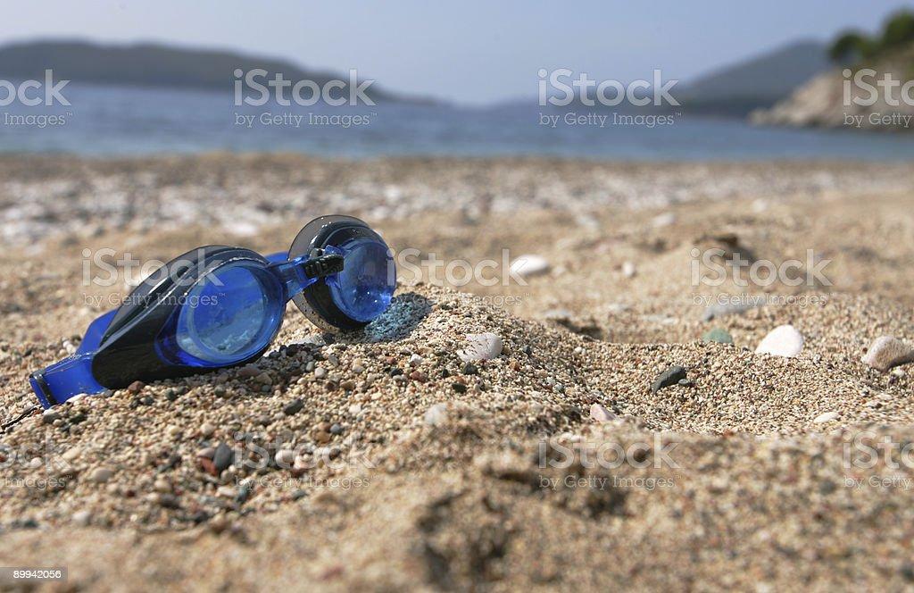 Eyeglasses at the beach royalty-free stock photo