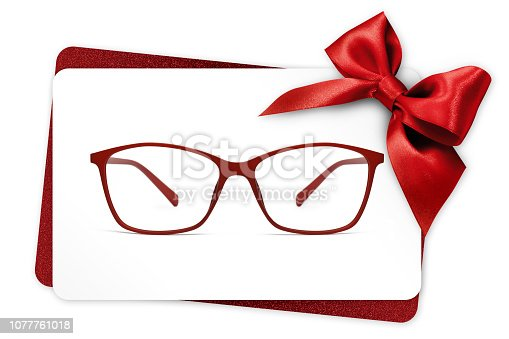 670414478 istock photo eyeglasses gift card, red spectacles and red ribbon bow, isolated on white background 1077761018