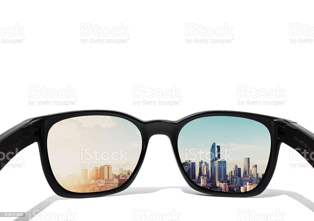 Eyeglasses, isolated on white background, with city view on lens stock photo