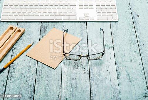 istock Eyeglasses on work place 1148564829