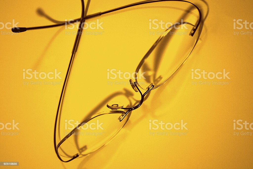 Eyeglasses on Yellow royalty-free stock photo