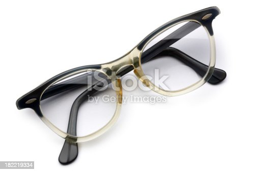 A pair of old eyeglasses from the 1950's or 1960's. Clipping path included.