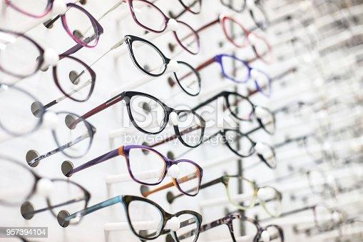 Large group of eyeglasses in an eyewear store display.