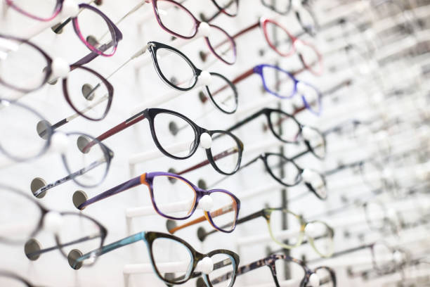 Eyeglasses Large group of eyeglasses in an eyewear store display. optical instrument stock pictures, royalty-free photos & images