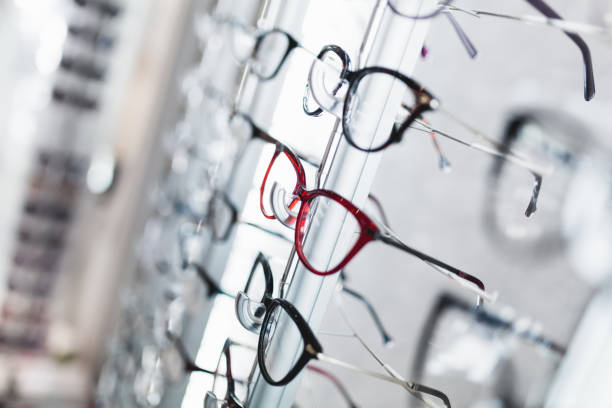 Eyeglasses store Close up shot of eyeglasses frames in optical store. optical instrument stock pictures, royalty-free photos & images