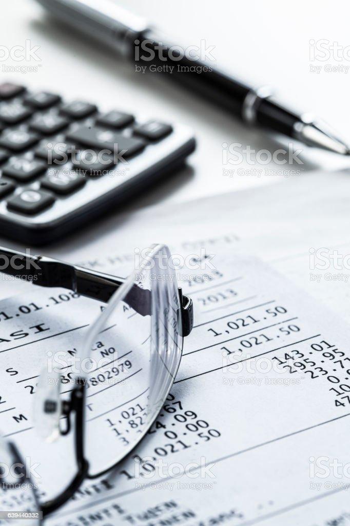 Eyeglasses with calculator on table - foto de acervo