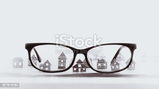 istock Eyeglasses  with paper houses, black and white. 827615282