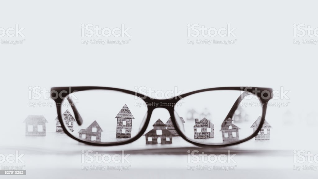 Eyeglasses  with paper houses, black and white. stock photo