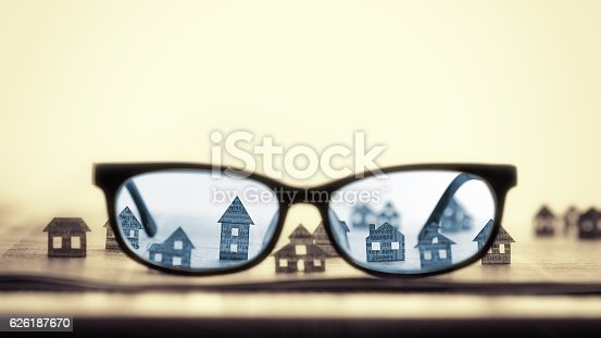 istock Eyeglasses  with paper houses 626187670