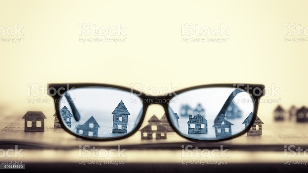 Eyeglasses  with paper houses stock photo