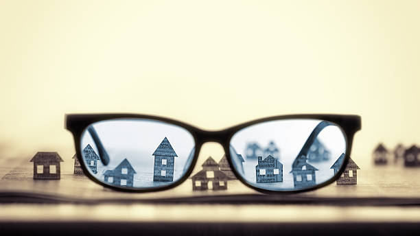 Eyeglasses  with paper houses - Photo