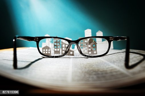 istock Eyeglasses  with paper houses. 827615396