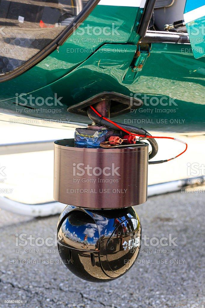 Eye-in-the-sky police helicopter camera stock photo