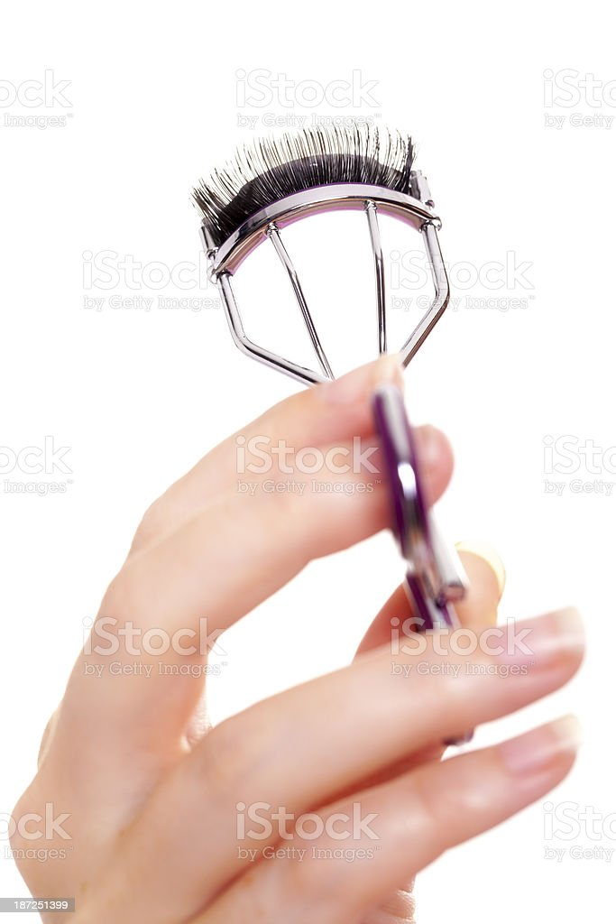 Eyelash curler with eye lash stock photo