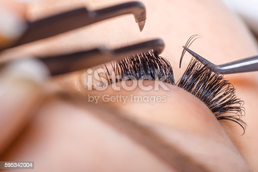 istock Eyelash Extension Procedure. Woman Eye with Long Eyelashes. Lashes. 595342004