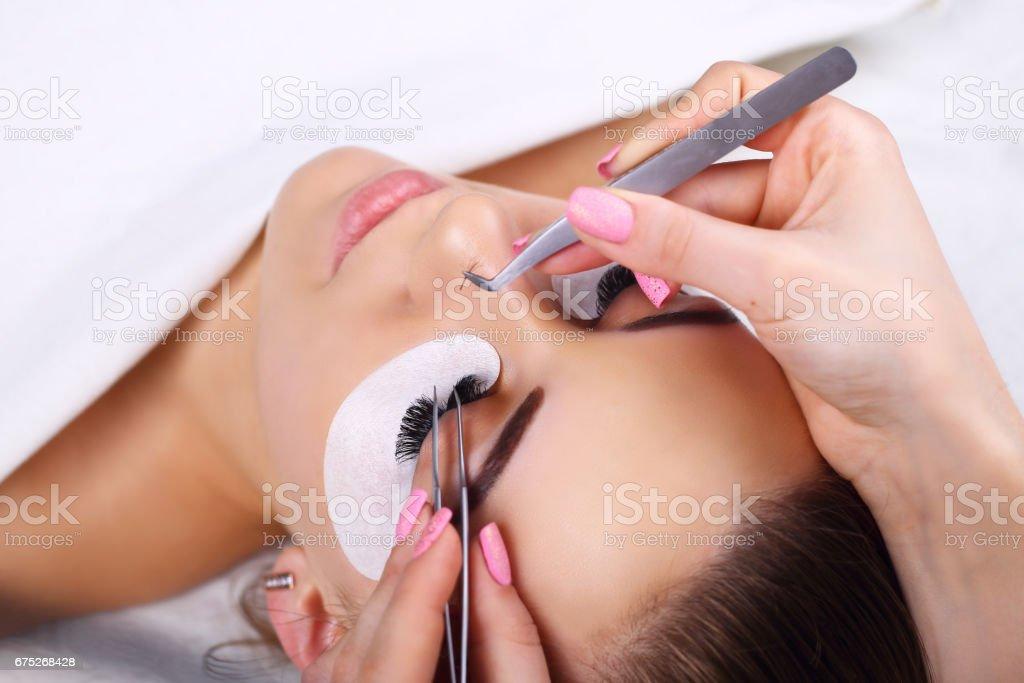 Eyelash Extension Procedure. Woman Eye with Long Eyelashes. Lashes, close up, macro, selective focus stock photo
