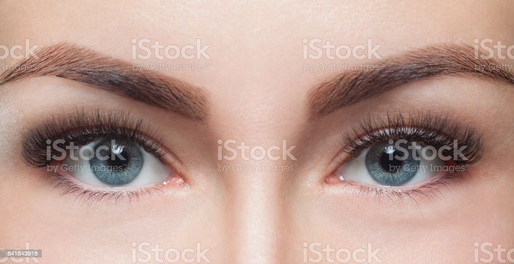 Eyelash removal procedure close up. Beautiful Woman with long lashes in a beauty salon stock photo