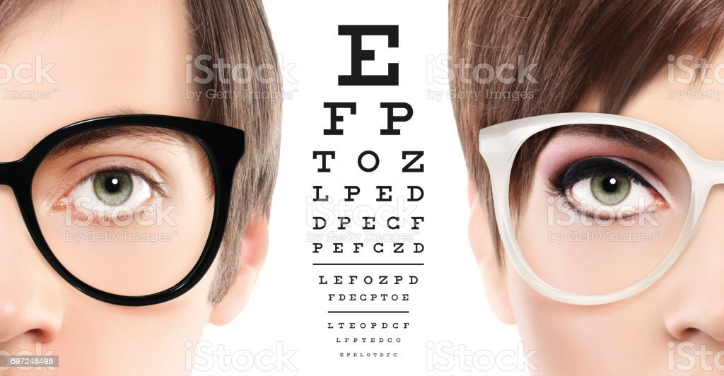 eyes and eyeglasses close up on visual test chart, eyesight and eye examination concept in white background stock photo