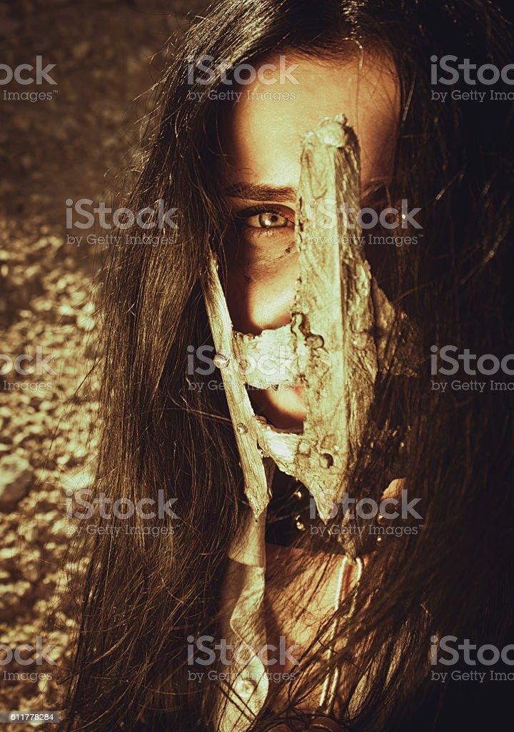 Eyes behind the iron mask stock photo