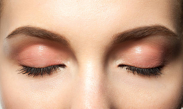 eyes closed with makeup - eyelid stock pictures, royalty-free photos & images