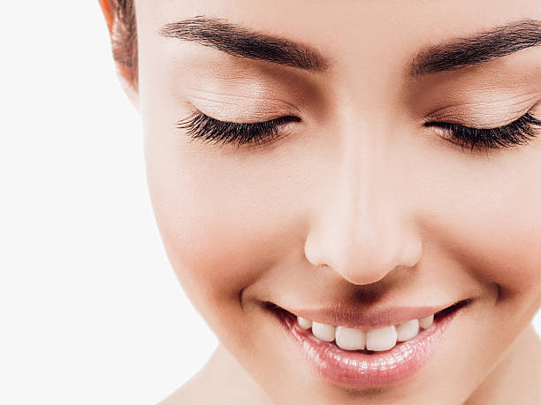 Eyes closeup. Woman beauty portrait with healthy skin teeth. stock photo
