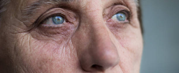 Eyes of a senior woman Eyes of a senior woman. Close up of senior woman face and eye abuse stock pictures, royalty-free photos & images