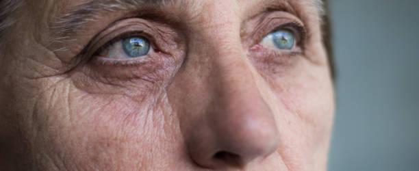 Eyes of a senior woman stock photo