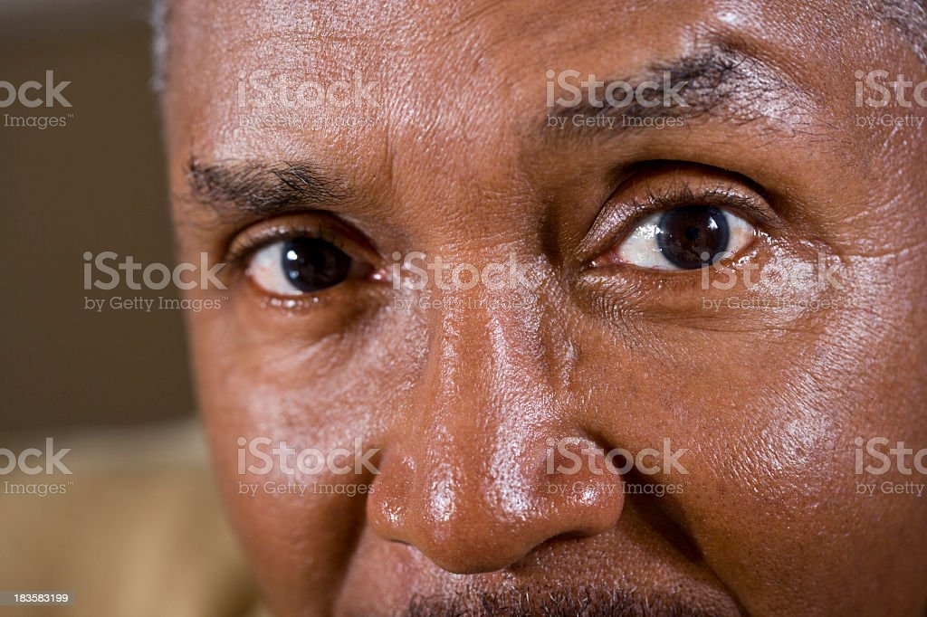 Eyes of mature African American man stock photo