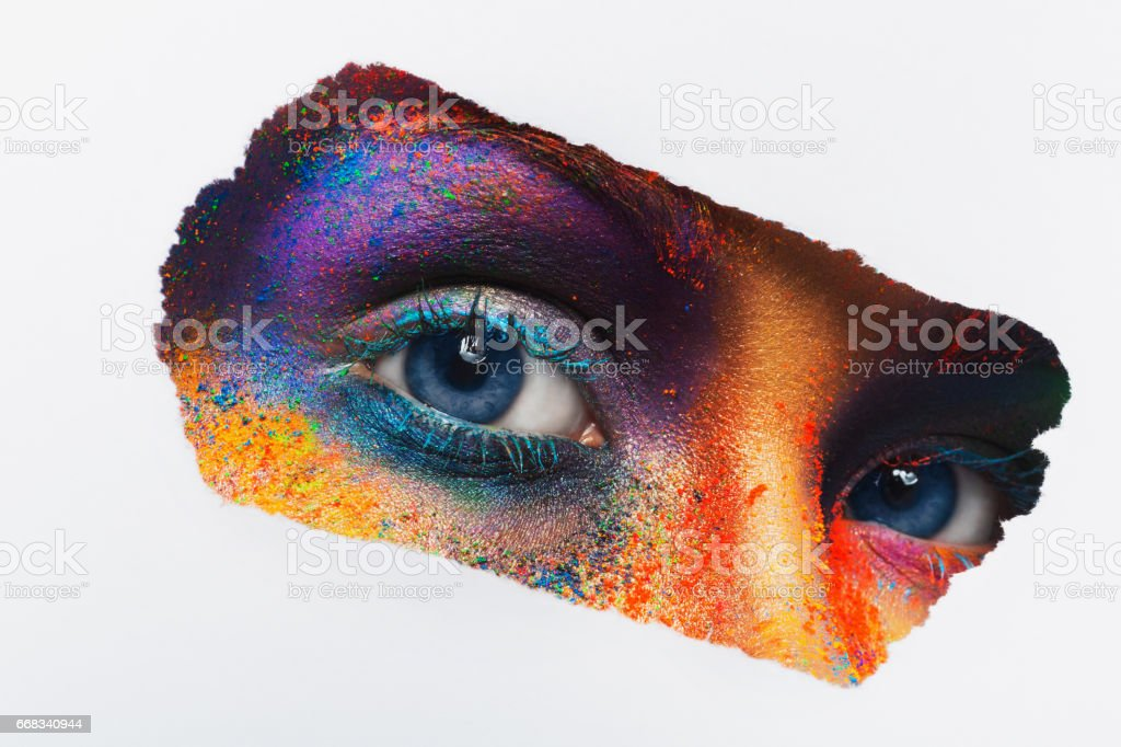 Eyes of model with colorful art make-up, close-up stock photo