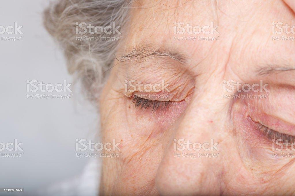 Eyes of tired senior woman. stock photo