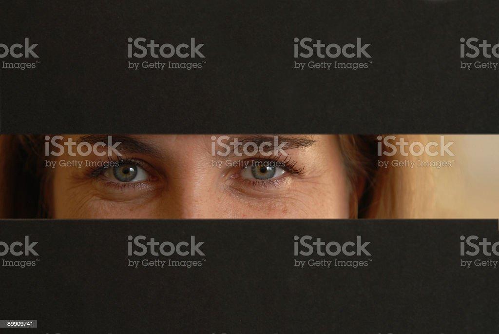 Eyes peeking royalty-free stock photo