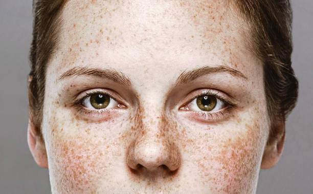 eyes woman young beautiful freckles woman face portrait with healthy skin - eye stock pictures, royalty-free photos & images