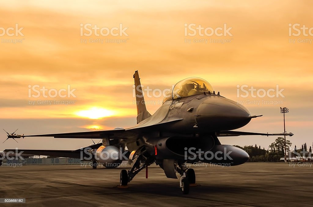 f16 falcon fighter jet  f16 falcon fighter jet in the base on sunset  background  Air Force Stock Photo