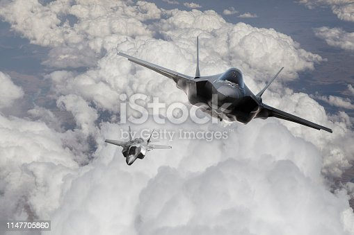 istock f-35 Fighter Jet flying over the clouds 1147705860
