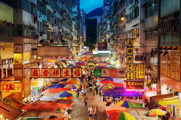 Fa Yuen Street Market in Hong Kong Busy street market at Fa Yuen Street at Mong Kok area of Kowloon, Hong Kong. night market stock pictures, royalty-free photos & images
